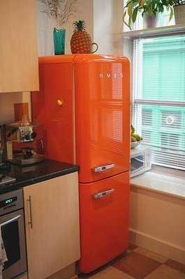 beautiful orange smeg in kitchen